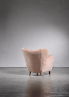 Lounge chair with lambskin upholstery 1940s - 1702417