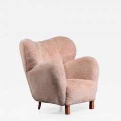 Lounge chair with lambskin upholstery 1940s - 1704681