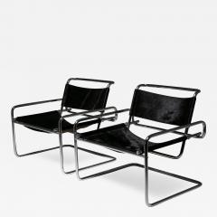 Luigi Saccardo Pair of Cantilever Steel chairs by Luigi Saccardo for Arrmet - 1086090