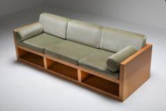 Moss green velvet and pitch pine three seat sofa 1960s - 1320541