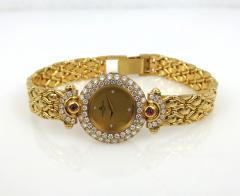 NEW OLD STOCK NEVER WORN BAUME MERCIER LADIES 18KT GOLD DIAMOND AND RUBY WATCH - 1087987