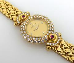 NEW OLD STOCK NEVER WORN BAUME MERCIER LADIES 18KT GOLD DIAMOND AND RUBY WATCH - 1087990