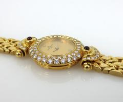 NEW OLD STOCK NEVER WORN BAUME MERCIER LADIES 18KT GOLD DIAMOND AND RUBY WATCH - 1087994