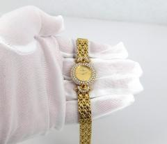 NEW OLD STOCK NEVER WORN BAUME MERCIER LADIES 18KT GOLD DIAMOND AND RUBY WATCH - 1087995