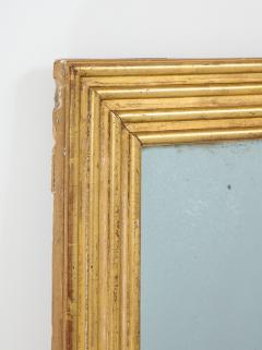 Neoclassical Italian gilded rectangular mirror with ribbed carving - 1013822