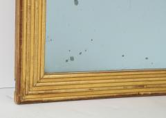 Neoclassical Italian gilded rectangular mirror with ribbed carving - 1013824