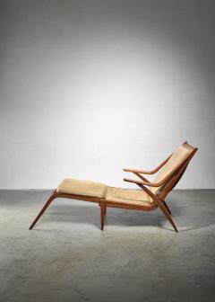 Oak lounge chair with fold out footstool - 1300590