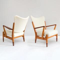PAIR OF SCANDINAVIAN MODERN LOUNGE CHAIRS WITH FAUX SHEEPSKIN TEAK DETAILS - 1120593