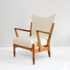 PAIR OF SCANDINAVIAN MODERN LOUNGE CHAIRS WITH FAUX SHEEPSKIN TEAK DETAILS - 1120594