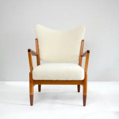 PAIR OF SCANDINAVIAN MODERN LOUNGE CHAIRS WITH FAUX SHEEPSKIN TEAK DETAILS - 1120597
