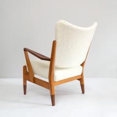 PAIR OF SCANDINAVIAN MODERN LOUNGE CHAIRS WITH FAUX SHEEPSKIN TEAK DETAILS - 1120598