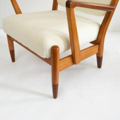 PAIR OF SCANDINAVIAN MODERN LOUNGE CHAIRS WITH FAUX SHEEPSKIN TEAK DETAILS - 1120599
