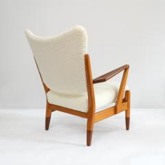 PAIR OF SCANDINAVIAN MODERN LOUNGE CHAIRS WITH FAUX SHEEPSKIN TEAK DETAILS - 1120602
