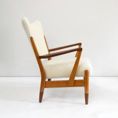 PAIR OF SCANDINAVIAN MODERN LOUNGE CHAIRS WITH FAUX SHEEPSKIN TEAK DETAILS - 1120603