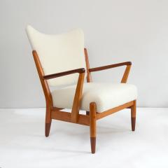 PAIR OF SCANDINAVIAN MODERN LOUNGE CHAIRS WITH FAUX SHEEPSKIN TEAK DETAILS - 1120605