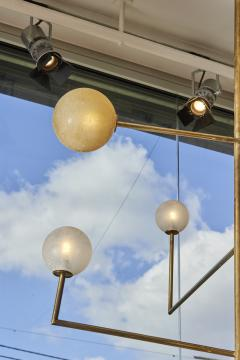 Pair of Brass Angular Chandeliers with Glass Globes - 1114520