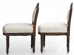 Pair of French Louis XVI Style Carved Walnut Antique Accent Side Chairs - 1125112