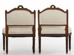 Pair of French Louis XVI Style Carved Walnut Antique Accent Side Chairs - 1125119