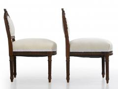 Pair of French Louis XVI Style Carved Walnut Antique Accent Side Chairs - 1125120