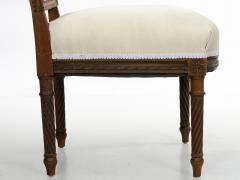Pair of French Louis XVI Style Carved Walnut Antique Accent Side Chairs - 1125121