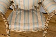 Pair of Louis XVI Style Parcel Gilt Upholstered Fauteuils - 671550