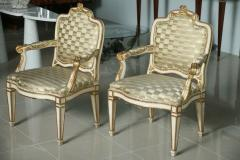 Pair of Swedish Neoclassic Cream Painted Parcel Gilt Arm Chairs - 83385