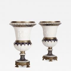 Pair of gilt bronze mounted krater form bisque porcelain vases - 1572700