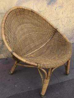 Pair of rattan oeuf shaped lounge chairs with brass leg end - 1033581