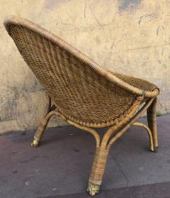 Pair of rattan oeuf shaped lounge chairs with brass leg end - 1033589