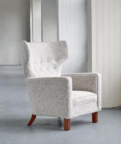 Paul Boman Paul Boman Wingback Chair in Pearl Boucl Fabric and Beech Finland 1940s - 1609769