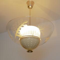 SCANDINAVIAN MODERN PENDANT WITH ETCHED GLASS AND PIERCED METAL SHADES - 1199469