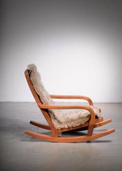 Scandinavian Modern pine rocking chair - 1989222