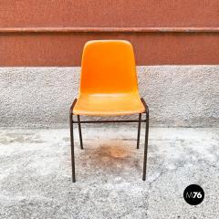 Stackable orange plastic chairs 1960s - 2135224