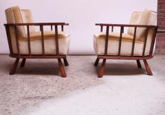 T H Robsjohn Gibbings Pair of T H Robsjohn Gibbings Stained Walnut Barrel Back Lounge Chairs - 1207949