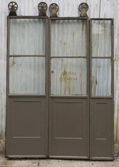 Three Door Sets of Vintage Commercial Metal Freight Elevator Doors - 243823 & Three Door Sets of Vintage Commercial Metal Freight Elevator Doors
