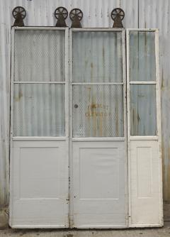 Three Door Sets of Vintage Commercial Metal Freight Elevator Doors - 243827 & Three Door Sets of Vintage Commercial Metal Freight Elevator Doors