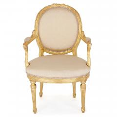 Two Louis XVI style giltwood upholstered fauteuil armchairs - 1516334