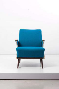 Upholstered Aerodynamic Lounge Chair 1950s - 1257648