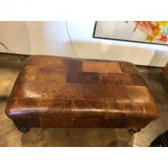 VINTAGE ENGLISH LEATHER PATCHWORK OTTOMAN OR BENCH - 1046513