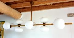 Very long brass white glass Mid Century Modern chandelier Italy 1970s - 1614351