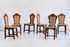 Victor Courtray Set of Six Victor Courtray Attributed Dining Chairs in Oak and Rush 1950s - 2047075