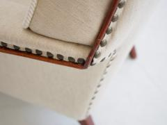 White Armchair with Stained Beech Legs and Stud Decorations - 1188134