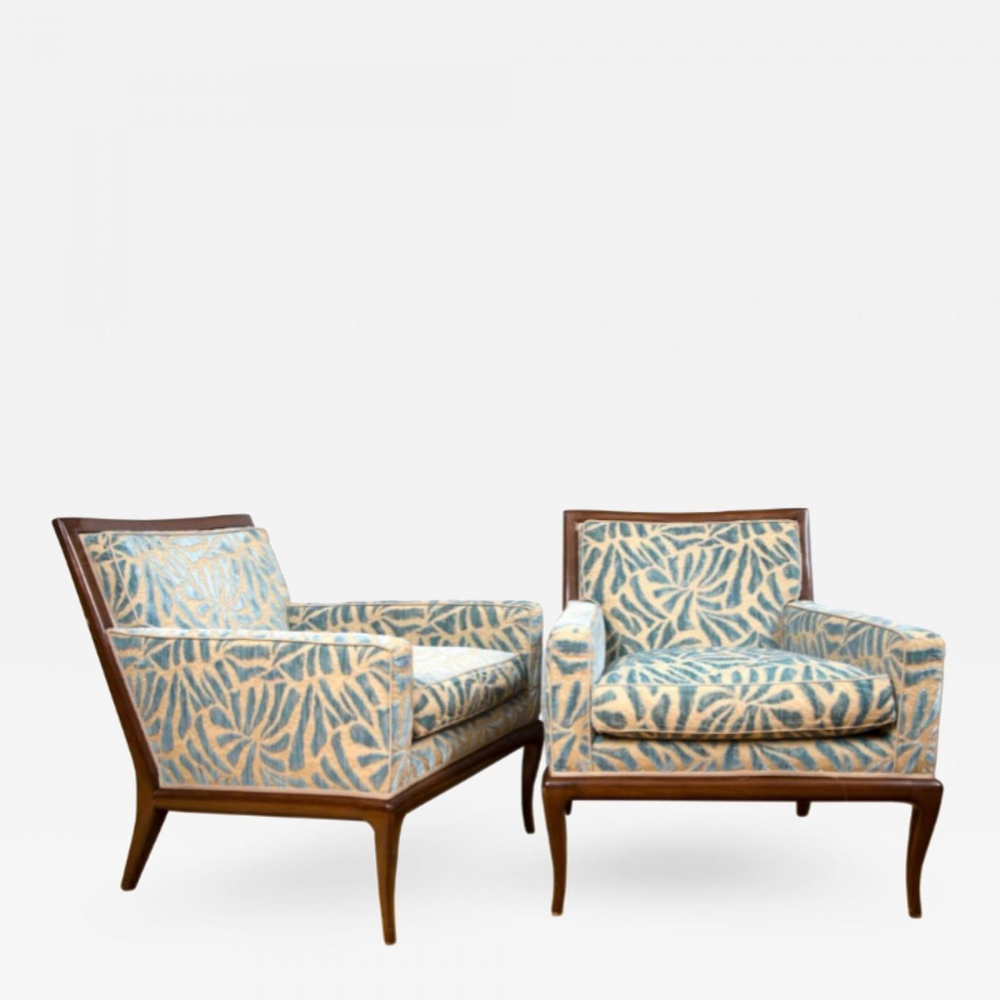 A pair of contemporary upholstered walnut lounge chairs