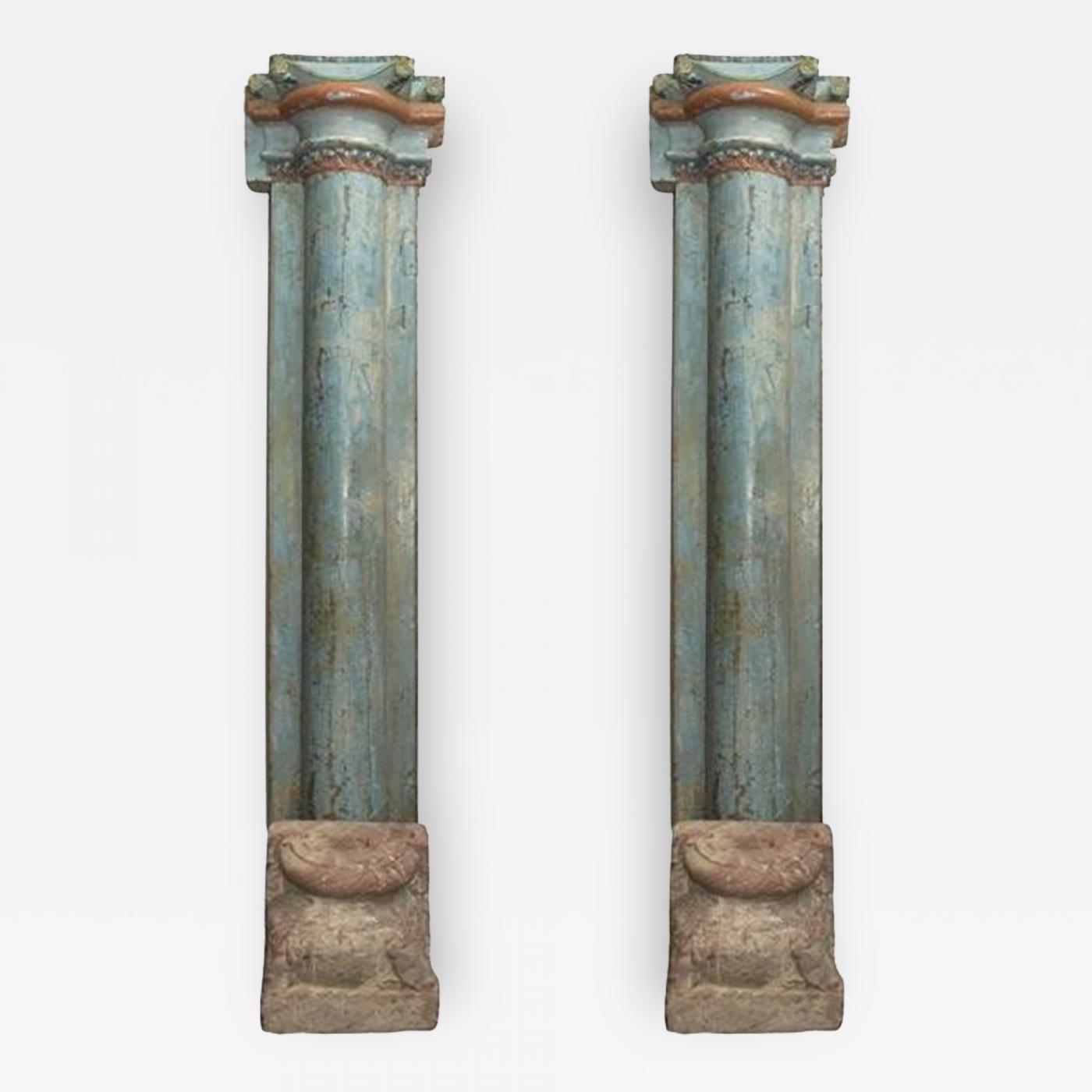 Round Wood Columns : A pair of half round wood columns with stone bases sold in