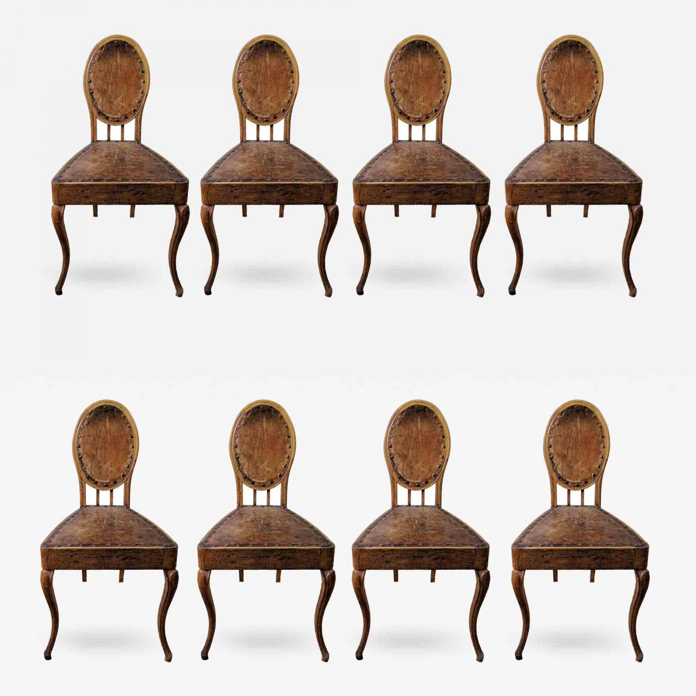 A Set Of Eight French Leather And Oak Art Nouveau Chairs Circa 1910