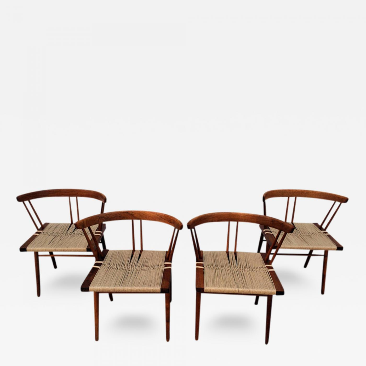 Set of four walnut and woven seat chairs