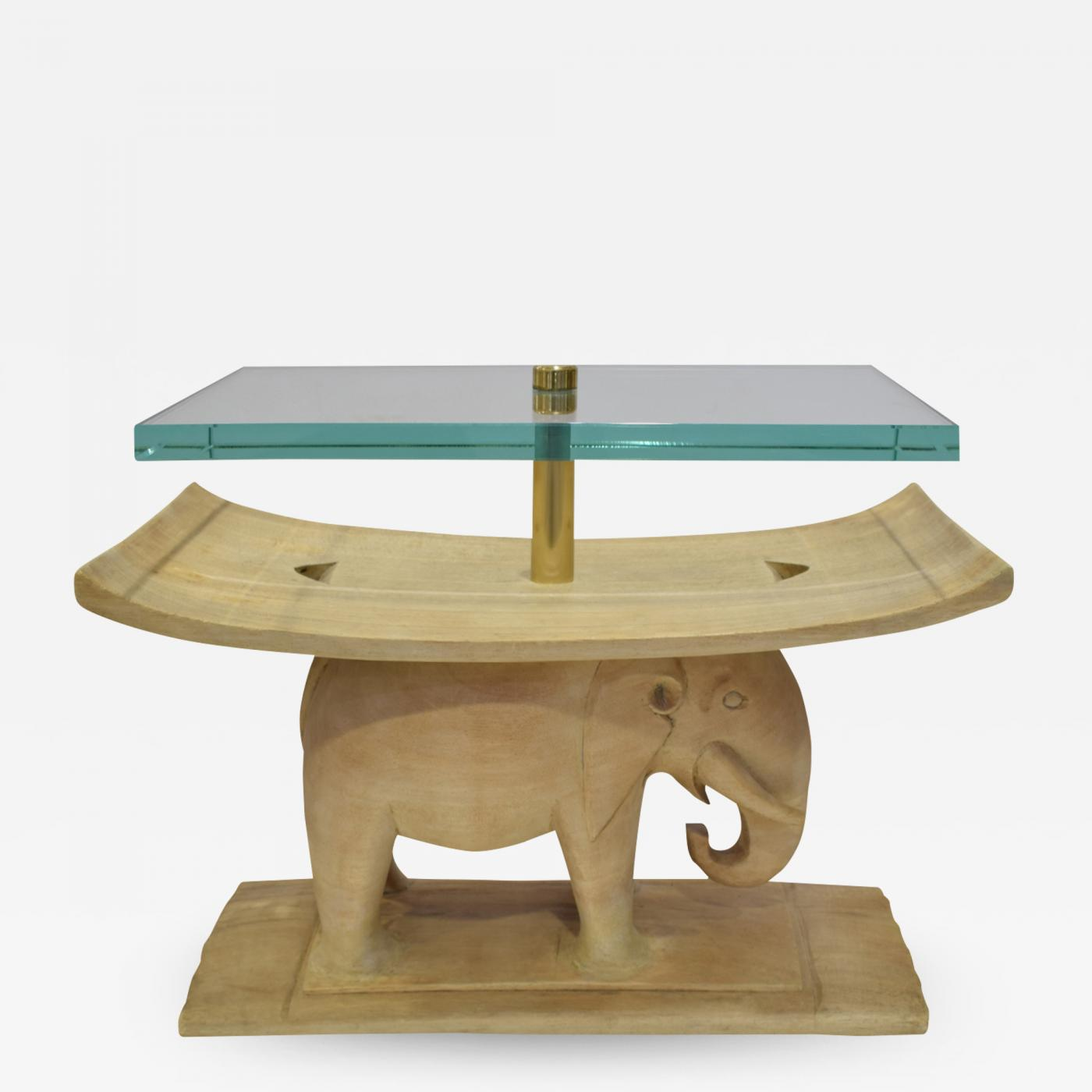 karl springer karl springer authentic african elephant table with floating glass top 1980s