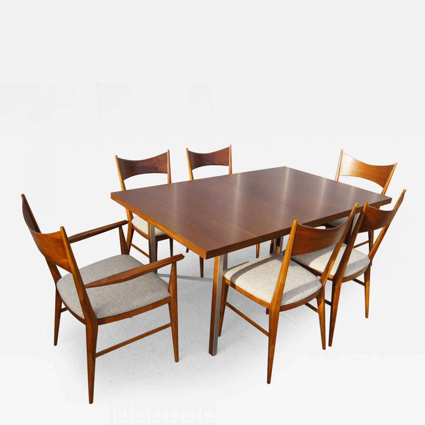 paul mccobb irwin group walnut dining table and six chairs by paul