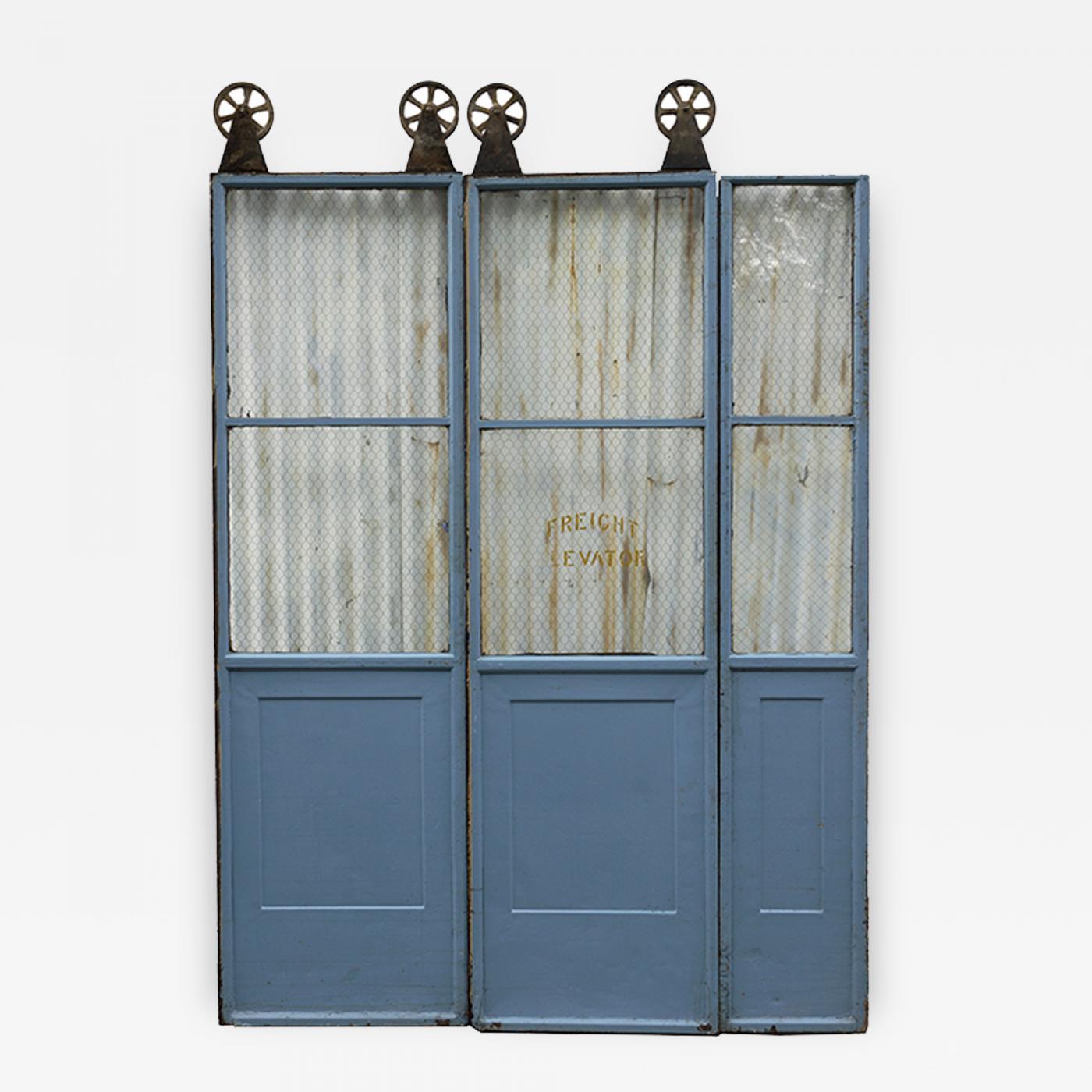 three door sets of vintage, commercial metal freight elevator doors